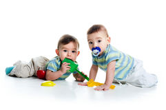Brothers with shovel and rake Stock Image
