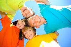 Brothers and sister. Four young siblings hold together Royalty Free Stock Photography