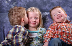 Brothers and sister. Studio Portrait with a little lady and her brothers Stock Photography