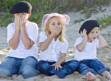 Brothers and sister on the beach Royalty Free Stock Images