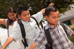 Brothers & Sister Having Fun Going to School. Cute Brothers and Sister with Backpacks Having Fun Walking to School Stock Photography