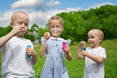 Brothers and sister are inflated bubbles Stock Photography