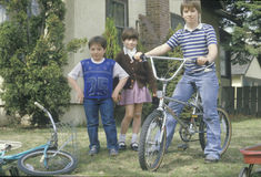 Brothers and sister with their bicycles Stock Photography