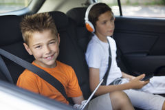 Brothers  sitting in a car Royalty Free Stock Photos