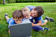 Brothers study on computer Royalty Free Stock Photos