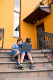 Brothers study on computer royalty free stock photography