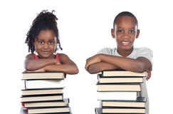 Brothers supported on a stack of books royalty free stock photo