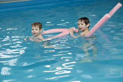 Brothers in swimming pool Royalty Free Stock Photography