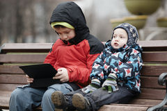 Brothers with tablet computer Royalty Free Stock Photo