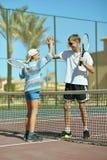 Brothers at tennis court Stock Photos