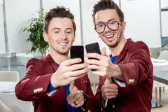 Brothers twins taking selfie photo Stock Photos