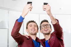 Brothers twins taking selfie photo Stock Image