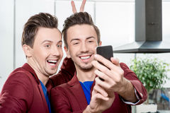 Brothers twins taking selfie photo Royalty Free Stock Images