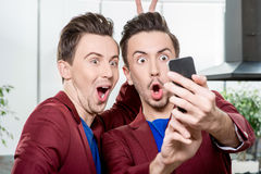 Brothers twins taking selfie photo Royalty Free Stock Photography
