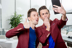 Brothers twins taking selfie photo Royalty Free Stock Image