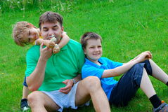 Brothers And Uncle In Meadow Stock Images