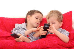 Brothers watching TV. Two brothers watching TV in bed Royalty Free Stock Image