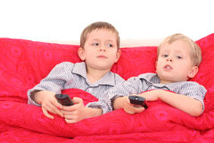 Brothers watching TV Stock Photos