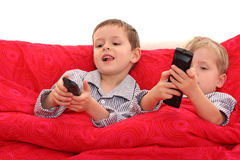 Brothers watching TV. Two brothers watching TV in bed Royalty Free Stock Photos