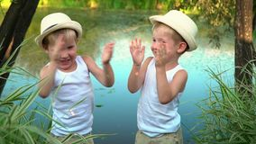 Brothers are whispered after fishing. happy children after fishing. stock footage