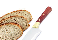 Brotscheiben und ein Messer stockbild