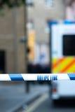 Brottsplats med polislinjen band Royaltyfria Bilder