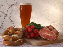 Brotzeit. Still Life with Beer and Pretzel, Radishes and Ham Stock Photography