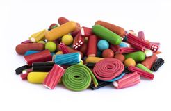 Brouillé des sucreries sur le fond blanc Photo stock
