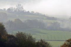 Brouillard au-dessous de colline de Downham Photographie stock