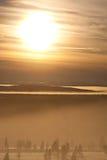 Brouillard dans le coucher du soleil Image libre de droits