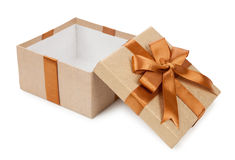 Broun box with gifts and bow isolated on white background.  royalty free stock image