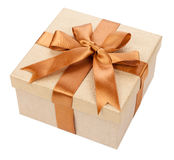 Broun box with gifts and bow isolated on white. Background royalty free stock images