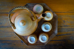 Broun ceramic teapot and cups for the tea ceremony on wooden tab Royalty Free Stock Photos