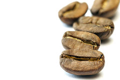 Broun coffee beans isolated on white background. shallow depth o. Broun coffee beans isolated on white background shallow depth of field stock image