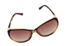 Broun Fashion sunglasses on white background. Fashion summer sun protected sunglasses on white background royalty free stock photo