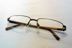 Broun reading glasses. Reading glasses on a white background royalty free stock photography