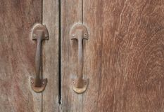 Old wood door or window with grunge Handles. Brow old wood door or window with grunge Handles royalty free stock photography