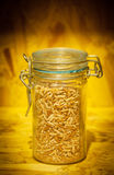 Brow rice in a glass bottle in blurry wood background Stock Photos