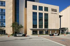 Broward County New Courthouse. FORT LAUDERDALE, FLORIDA, USA - OCTOBER 21, 2018: Two Broward County Sheriff cars provide security in front of the Broward County stock photography