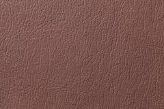Brown überziehen Beschaffenheitshintergrund mit Muster, Nahaufnahme mit Leder Lizenzfreies Stockfoto