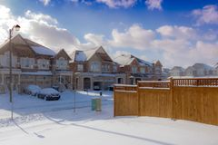 Brown 2-storey Houses during Snow Stock Photography