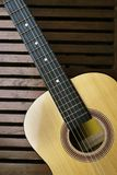 Brown Acoustic Guitar on Brown Wooden Board royalty free stock photos
