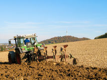 Brown Acre with green Tractor Stock Image