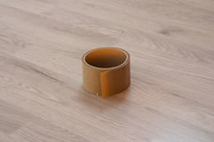 Brown adhesive tape on wood laminate background royalty free stock image