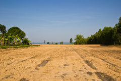 Brown agricultural soil of a field Stock Photography
