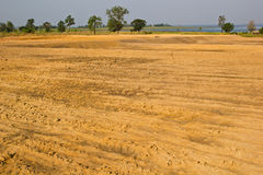 Brown agricultural soil of a field Royalty Free Stock Photography