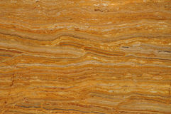 Brown and amber marble. This brown and amber marble has been ground and polished and is commonly used on any area that requires a durable weather resistant Royalty Free Stock Image