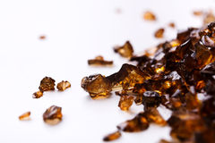 Brown Amber stones on white background Royalty Free Stock Photography