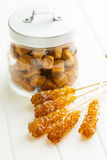 Brown amber sugar crystal on wooden stick. Stock Image