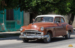 Brown american classic car drives on the street in the province Villa Clara Stock Image